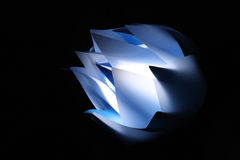 Glowing Lotus. A glowing lotus-inspired lamp made with blue paper and plastic Royalty Free Stock Images