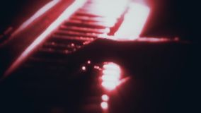 Man Playing a Red Particles Piano - Hands Close Up - Motion Background. Glowing Man Playing a Red Particles Piano - Hands Close Up - Motion Background backdrop stock footage