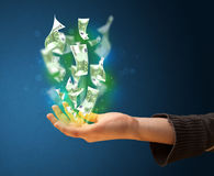 Glowing money in the hand of a woman Stock Images