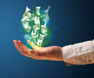 Glowing money in the hand of a woman Stock Photography