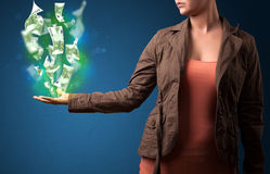 Glowing money in the hand of a woman Royalty Free Stock Photo