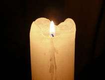 Glowing mourning candle in darkness. Stock Image