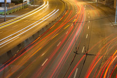 Glowing multicolored stripes left by car headlights Royalty Free Stock Photography