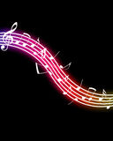Glowing Music Notes. On black background. Please visit my portfolio for more Royalty Free Stock Photo