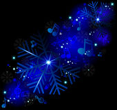 Glowing music notes with winter snowflakes Royalty Free Stock Image