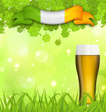 Glowing nature background with glass of beer, clovers, grass Royalty Free Stock Photos