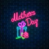 Glowing neon banner of mothers holiday on dark brick wall background. Spring world mothers day greeting card. With gift box and rose flower. Vector illustration vector illustration