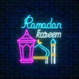 Glowing neon banner of ramadan islamic holy month. Ramadan greeting card with fanus lantern and mosque. Royalty Free Stock Image