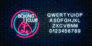 Glowing neon boxing club sign with alphabet. Fighting club neon signboard. Nightlife boxing symbol of sport facility. Glowing neon boxing club sign in circle Royalty Free Stock Photography