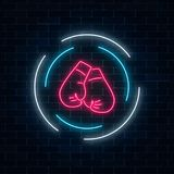 Glowing neon boxing club sign in circle frame on dark brick wall background. Fighting club neon signboard. Nightlife advertising symbol of sport facility on Royalty Free Stock Image