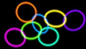 Glowing neon circles of different colors connected with each other. 3D rendered art. Glowing neon circles of different colors connected with each other. Black Royalty Free Illustration