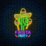 Glowing neon fiesta holiday sign. Mexican festival flyer design with maracas, sombrero hat and cactus. Glowing neon fiesta holiday sign on dark brick wall Royalty Free Stock Photo