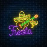 Glowing neon fiesta holiday sign. Mexican festival flyer design with guitar, maracas and sombrero hat. Glowing neon fiesta holiday sign on dark brick wall Stock Images