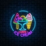 Glowing neon ice cream cafe signboard in circle frame on dark brick wall background. Fruit cone and watermelon ice-cream. Glowing neon ice cream cafe signboard Royalty Free Stock Photo