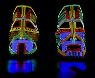 Glowing neon indian masks Stock Photography
