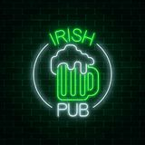 Glowing neon irish pub signboard in circle frame with text on dark brick wall background. Stock Images