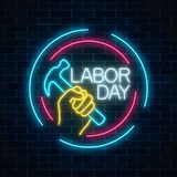 Glowing neon labor day sign in circle frames on dark brick wall background. World labor day symbol with hammer in hand. Vector illustration Stock Images