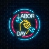 Glowing neon labor day sign in circle frames on dark brick wall background. World labor day symbol with wrench in hand. Vector illustration Royalty Free Stock Photo