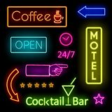 Glowing Neon Lights for Cafe and Motel Signs. Colorful Glowing Neon Lights Graphic Designs for Cafe and Motel Signs on Black Background Royalty Free Stock Image