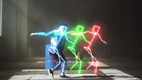 Glowing neon lines modern colorful illumination. Professional young asian hip-hop male dancer in sport wear dancing in. Young asian hip-hop male dancer in sport stock footage