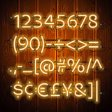 Glowing Neon Numbers on Wooden Background Royalty Free Stock Image