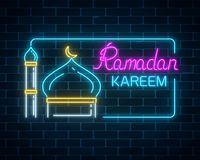 Glowing neon ramadan kareem greeting text with mosque dome and minaret in rectangle frame. Glowing neon banner of ramadan islamic holy month on dark brick wall Stock Images