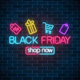 Glowing neon sign of black friday sale with shopping symbols. Seasonal sale web banner. Black friday light signboard. Glowing neon sign of black friday sale vector illustration