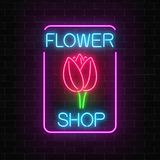 Glowing neon sign of floral shop in rectangle frame. Design of flower store signboard with tulip. Glowing neon sign of floral shop in rectangle frame on dark Royalty Free Stock Images