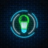 Glowing neon sign of green led light bulb in circle frame on dark brick wall background. Eco energy. Concept symbol. Vector illustration Stock Photography