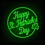 Glowing neon sign - Happy St. Patrick`s Day text. Glowing neon sign - Happy St. Patrick`s Day text with shamrock on a dark green background Stock Images