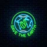 Glowing neon sign of world earth day with leaves in globe symbol and text on dark brick wall background. Earth day neon banner. Vector illustration Royalty Free Stock Images