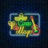 Glowing neon sinco de mayo holiday sign in rectangle frame on dark brick wall background. Mexican festival flyer. Glowing neon sinco de mayo holiday sign in Stock Photo