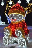 Glowing Neon snowman Stock Photo