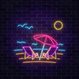 Glowing neon summer sign with chaise lounges, beach umbrella, ocean and gulls on dark brick wall background. Shiny summertime symbol. Deck chairs under Stock Photos