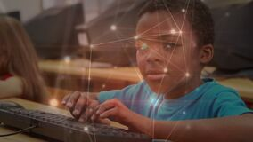 Glowing network of connections against portrait of african american boy using computer at school