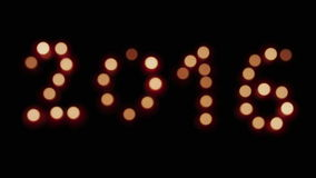 Glowing and nice defocus 2016. Glowing candles and nice defocus  2016 on black background stock video