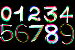 Glowing numbers. Illustrated glowing numbers over a dark background stock photos