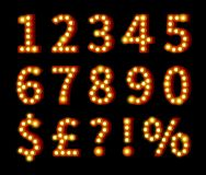 Glowing Numbers and Symbols on Black Stock Photos