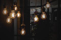A glowing old light bulbs. On the dark background royalty free stock photography