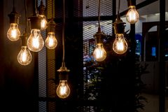 A glowing old light bulbs. On the dark background royalty free stock images