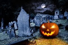 Free Glowing Orange Halloween Pumpkin On Old Graveyard Front Of Full Moon Black Raven Church Dark Night Spooky Horror Background Royalty Free Stock Photos - 160627528