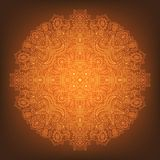 Glowing orange mandala on a gradient background. royalty free stock image