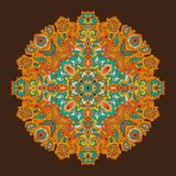 Glowing orange mandala on a gradient background. royalty free stock photography