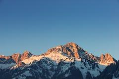 Glowing orange mountain peak royalty free stock image