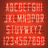 Glowing Orange Neon Casual Script Font. With uppercase letters from A to Z and digits from 0 to 9 with wires, tubes, brackets and holders. Shining and glowing Stock Photography
