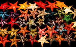 Glowing Paper Star Christmas Decorations in Black Background. Glowing Paper Star Christmas Decorations in Background Black stock photos