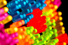 Glowing Pegs. GLowing Colored Pegs Stock Images