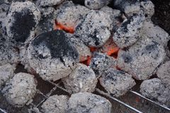 the glowing pieces of charcoal lie on the grill royalty free stock photos