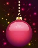 Glowing pink Christmas bauble hanging on beads Stock Photo