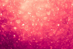 Glowing pink hearts background Stock Photos